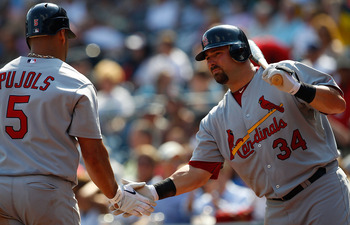 PITTSBURGH - SEPTEMBER 23:  Albert Pujols #5 of the St Louis Cardinals is congratulated by teammate Nick Stavinoha #34 after hitting his second home run of the game against the Pittsburgh Pirates during the game on September 23, 2010 at PNC Park in Pittsb