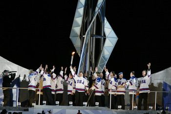 SALT LAKE CITY - FEBRUARY 8:  Mike Eruzione, captain of the 1980 'Miracle on Ice' US Hockey Team and the rest of the gold medal hockey squad prepare to light the Olympic Cauldron during the Opening Ceremony of the Salt Lake City Winter Olympic Games on Fe