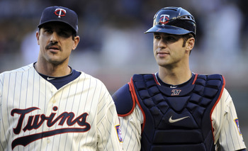 MINNEAPOLIS, MN - OCTOBER 7: Starting pitcher Carl Pavano #48 and catcher Joe Mauer #7 of the Minnesota Twins walk to the dugout prior to game two of the ALDS game against the New York Yankees on October 7, 2010 at Target Field in Minneapolis, Minnesota.