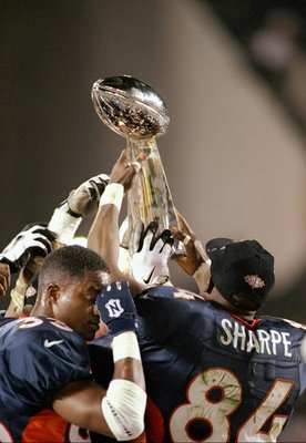 25 Jan 1998:  The Denver Broncos players hold up the Lombardi Trophy after defeating the Green Bay Packers in Super Bowl  XXXII at Qualcomm Stadium in San Diego, California.  The Denver Broncos defeated the Green Bay Packers 31-24. Mandatory Credit: Doug