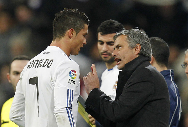 MADRID, SPAIN - DECEMBER 19:  Head coach Jose Mourinho (R) of Real Madrid gives instructions to Cristiano Ronaldo during the La Liga match between Real Madrid and Sevilla at Estadio Santiago Bernabeu on December 19, 2010 in Madrid, Spain. Real Madrid won