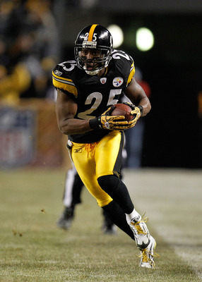 PITTSBURGH, PA - JANUARY 15:  Safety Ryan Clark #25 of the Pittsburgh Steelers runs back the ball after an interception of quarterback Joe Flacco #5 of the Baltimore Ravens in the third quarter of the AFC Divisional Playoff Game at Heinz Field on January