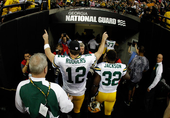 ATLANTA, GA - JANUARY 15:  Aaron Rodgers #12 and Brandon Jackson #32 of the Green Bay Packers celebrate as they walk off the field after the Packers won 48-21 against the Atlanta Falcons during their 2011 NFC divisional playoff game at Georgia Dome on Jan