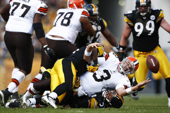 PITTSBURGH, PA - OCTOBER 18: Derek Anderson #3 of the Cleveland Browns fumbles the football after being sacked by James Farrior #51 of the Pittsburgh Steelers at Heinz Field on October 18, 2009 in Pittsburgh, Pennsylvania. The Steelers defeated the Browns