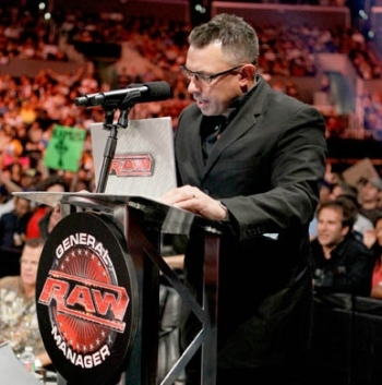 Michael Cole reading an email from the anonymous RAW GM, photo copyright to WWE.com