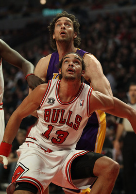 CHICAGO, IL - DECEMBER 10: Joakim Noah #13 of the Chicago Bulls boxes out Pau Gasol #16 of the Los Angeles Lakers at the United Center on December 10, 2010 in Chicago, Illinois. The Bulls defeated the Lakers 88-84. NOTE TO USER: User expressly acknowledge