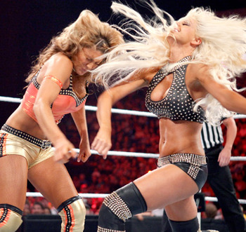 Maryse and Eve in a match, photo copyright to WWE.com