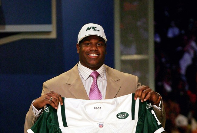 NEW YORK - APRIL 29:  D'Brickashaw Ferguson holds up a jersey after being selected fourth overall by the New York Jets in the 2006 NFL Draft at Radio City Music Hall on April 29, 2006 in New York City.  (Photo by Ezra Shaw/Getty Images)