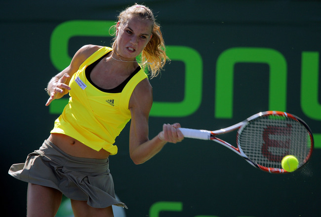 KEY BISCAYNE, FL - MARCH 25:  Arantxa Rus of Netherlands returns a shot against Magdalena Rybarikova of Slovakia during day three of the Sony Ericsson Open at The Crandon Park Tennis Center on March 25, 2009 in Key Biscayne, Florida.  (Photo by Matthew St
