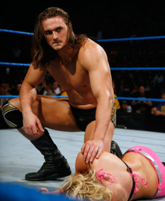 Drew McIntyre checking on Kelly Kelly, photo copyright to WWE.com