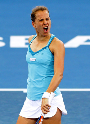 BRISBANE, AUSTRALIA - JANUARY 06:  Barbora Zahlavova Strycova of the Czech Republic reacts after losing a point during her quarter final match against Marion Bartoli of France during day five of the Brisbane International at Queensland Tennis Centre on Ja