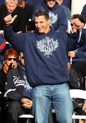 NEW YORK - NOVEMBER 06:  Andy Pettitte #46 of the New York Yankees waves to the crowd after accepting his key to the city at the New York Yankees World Series Victory Celebration at City Hall on November 6, 2009 in New York, New York.  (Photo by Jim McIsa