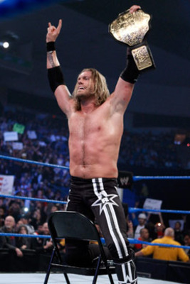Edge with the World title, photo copyright to WWE.com