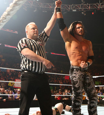 John Morrison victorious, photo copyright to WWE.com
