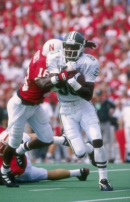 7 Sep 1996:  Wide receiver Derrick Mason of the Michigan State Spartans attempts to break free from the grasp of defensive back Eric Stokes of the Nebraska Cornhuskers during a reception in the Spartans 55-14 loss to the Cornhuskers at Memorial Stadium in