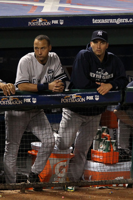 ARLINGTON, TX - OCTOBER 22:  Derek Jeter #2 and Andy Pettitte #46 of the New York Yankees look on from the dugout in Game Six of the ALCS against the Texas Rangers during the 2010 MLB Playoffs at Rangers Ballpark in Arlington on October 22, 2010 in Arling