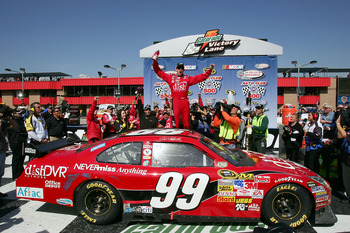 FONTANA, CA - FEBRUARY 25:  Carl Edwards, driver of the #99 Dish Network Ford, celebrates in victory lane after winning the NASCAR Sprint Cup Series Auto Club 500 at the Auto Club Speedway of Southern California on February 25, 2008 in Fontana, California