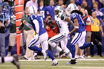 INDIANAPOLIS, IN - JANUARY 08:  Antonio Cromartie #31 of the New York Jets returns a kickoff 47-yards in the final minute of the fourth quarter against kicker Pat McAfee #1 of the Indianapolis Colts during their 2011 AFC wild card playoff game at Lucas Oi