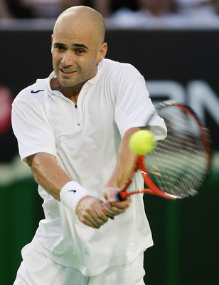 MELBOURNE, AUSTRALIA - JANUARY 25: Andre Agassi of the USA in action against Roger Federer of Switzerland during day nine of the Australian Open Grand Slam at Melbourne Park January 25, 2005 in Melbourne, Australia.  (Photo by Clive Brunskill/Getty Images