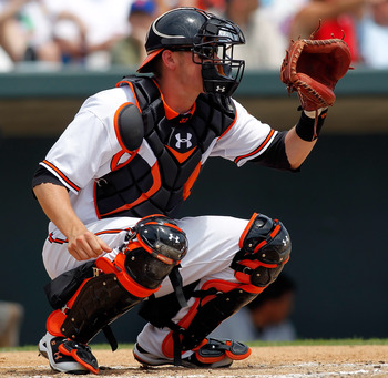 SARASOTA, FL - APRIL 03:  Catcher Matt Wieters #32 of the Baltimore Orioles catches against the New York Mets during a Grapefruit League Spring Training Game at Ed Smith Stadium on April 3, 2010 in Sarasota, Florida.  (Photo by J. Meric/Getty Images)