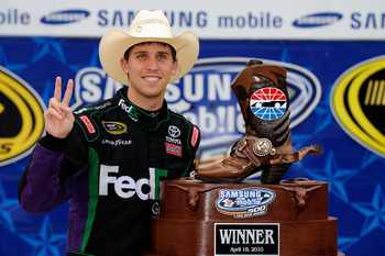 FORT WORTH, TX - APRIL 19:  Denny Hamlin, driver of the #11 of the FedEx Ground Toyota, poses with the trophy in victory lane after he won the NASCAR Sprint Cup Series Samsung Mobile 500 at Texas Motor Speedway on April 19, 2010 in Fort Worth, Texas.  (Ph