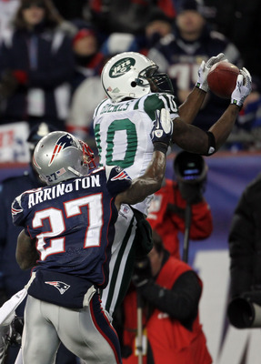 FOXBORO, MA - JANUARY 16:  Santonio Holmes #10 of the New York Jets makes a fourth quarter touchdown reception over Kyle Arrington #27 of the New England Patriots during their 2011 AFC divisional playoff game at Gillette Stadium on January 16, 2011 in Fox