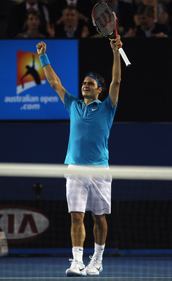 MELBOURNE, AUSTRALIA - JANUARY 31:  Roger Federer of Switzerland celebrates championship point in his men's final match against Andy Murray of Great Britain during day fourteen of the 2010 Australian Open at Melbourne Park on January 31, 2010 in Melbourne