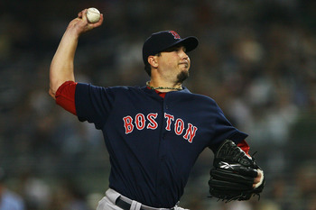 NEW YORK - SEPTEMBER 24:  Josh Beckett #19 of the Boston Red Sox pitches against the New York Yankees on September 24, 2010 at Yankee Stadium in the Bronx borough of New York City.  (Photo by Andrew Burton/Getty Images)