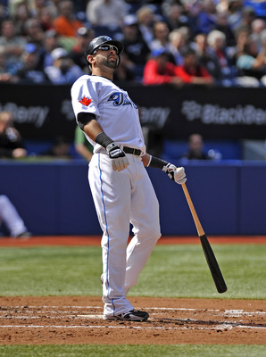 TORONTO - SEPTEMBER 23:   Jose Bautista #19 of the Toronto Blue Jays watches his foul ball during the game against the Seattle Mariners on September 23, 2010 at Rogers Centre in Toronto, Ontario, Canada. The Blue Jays defeated the Mariners 1-0. (Photo by