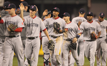 SEATTLE - SEPTEMBER 14:  Members of the Boston Red Sox celebrate after defeating the Seattle Mariners 9-6 at Safeco Field on September 14, 2010 in Seattle, Washington. The Red Sox won 9-6. (Photo by Otto Greule Jr/Getty Images)