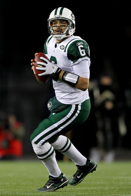 FOXBORO, MA - JANUARY 16:  Mark Sanchez #6 of the New York Jets drops back during their 2011 AFC divisional playoff game against the New England Patriots at Gillette Stadium on January 16, 2011 in Foxboro, Massachusetts.  (Photo by Jim Rogash/Getty Images