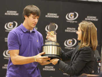 Quarterback Justin Worley receives the Gatorade National Football Player of the Year award.