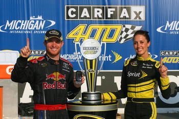 BROOKLYN, MI - AUGUST 16:  Brian Vickers, driver of the #83 Red Bull Toyota, celebrates in victory lane after winning the NASCAR Sprint Cup Series CARFAX 400 at Michigan International Speedway on August 16, 2009 in Brooklyn, Michigan.  (Photo by Jason Smi