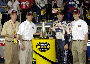 CONCORD, NC - MAY 29:  Jimmie Johnson, driver of the #48 Lowe's Chevrolet, poses with Senator Bill Frist (R-TN) (R) in Victory Lane after winning the NASCAR Nextel Cup Series Coca-Cola 600 on May 29, 2005 at the Lowe's Motor Speedway in Concord, North Car