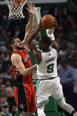BOSTON, MA - JANUARY 07:  Linas Kleiza #11 of the Toronto Raptors tries to block Rajon Rondo #9 of the Boston Celtics on January 7, 2011 at the TD Garden in Boston, Massachusetts. The Celtics defeated the Raptors 122-102. NOTE TO USER: User expressly ackn