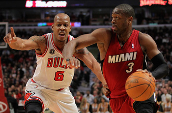 CHICAGO, IL - JANUARY 15:  Dwayne Wade #3 of the Miami Heat drives to the basket against Keith Bogans #6 of the Chicago Bulls at the United Center on January 15, 2011 in Chicago, Illinois. NOTE TO USER: User expressly acknowledges and agrees that, by down