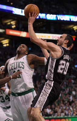 BOSTON, MA - JANUARY 05:  Manu Ginobili #20 of the San Antonio Spurs shoots past Glen Davis #11 of the Boston Celtics on January 5, 2011 at the TD Garden in Boston, Massachusetts. The Celtics defeated the Spurs 105-103. NOTE TO USER: User expressly acknow