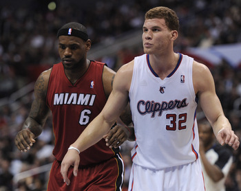 LOS ANGELES, CA - JANUARY 12:  Blake Griffin #32 of the Los Angeles Clippers and LeBron James #6 of  the Miami Heat wait at during a free throw during the first half at the Staples Center on January 12, 2011 in Los Angeles, California.  NOTE TO USER: User