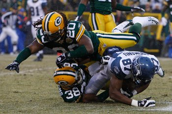 GREEN BAY, WI - JANUARY 12:  Wide receiver Ben Obomanu #87 of the Seattle Seahawks is tackled by cornerback Tramon Williams #38 and safety Atari Bigby #20 of the Green Bay Packers during the NFC divisional playoff game on January 12, 2008 at Lambeau Field