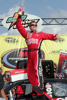 BROOKLYN, MI - AUGUST 17:  Carl Edwards, driver of the #99 Office Depot Ford, celebrates in victory lane after winning the NASCAR Sprint Cup Series 3M Performance 400 at Michigan International Speedway on August 17, 2008 in Brooklyn, Michigan.  (Photo by