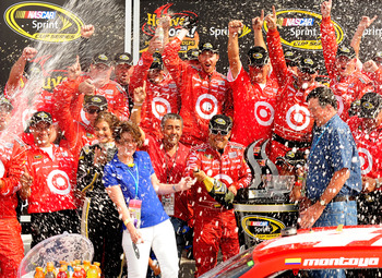 WATKINS GLEN, NY - AUGUST 08:  Juan Pablo Montoya (L), driver of the #42 Target Chevrolet, celebrates with his team after winning the NASCAR Sprint Cup Series Heluva Good! Sour Cream Dips at Watkins Glen International on August 8, 2010 in Watkins Glen, Ne