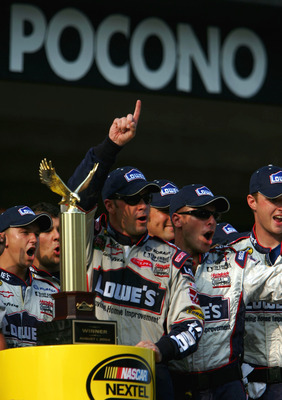 LONG POND, PA - AUGUST 1:  Jimmie Johnson driver of the #48 Lowe's Chevrolet  celebrates with the trophy and his crew in victory lane during the NASCAR Nextel Cup Pennsylvania 500 on August 1, 2004 at Pocono Raceway in Long Pond, Pennsylvania. (Photo by J