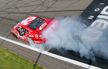 WATKINS GLEN, NY - AUGUST 08:  Juan Pablo Montoya, driver of the #42 Target Chevrolet, performs a burnout after winning the NASCAR Sprint Cup Series Heluva Good! Sour Cream Dips at Watkins Glen International on August 8, 2010 in Watkins Glen, New York.  (