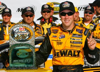 BROOKLYN - AUGUST 20:  Matt Kenseth, driver of the #17 DeWalt Ford, poses for pictures in victory lane after winning the NASCAR Nextel Cup Series GFS Marketplace 400 on August 20, 2006 at Michigan International Speedway in Brooklyn, Michigan.  (Photo by R