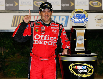 HAMPTON, GA - SEPTEMBER 05: Tony Stewart, driver of the #14 Office Depot/Old Spice Chevrolet, celebrates in victory lane after winning the NASCAR Sprint Cup Series Emory Healthcare 500 at Atlanta Motor Speedway on September 5, 2010 in Hampton, Georgia.  (