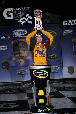 RICHMOND, VA - MAY 01:  Kyle Busch, driver of the #18 M&M's Toyota, celebrates with the trophy in victory lane after winning the NASCAR Sprint Cup Series Crown Royal Presents the Heath Calhoun 400 at Richmond International Raceway on May 1, 2010, 2010 in