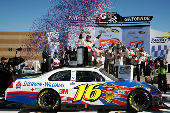 KANSAS CITY, KS - OCTOBER 03:  Greg Biffle, driver of the #16 3M Ford, celebrates in victory lane after winning the NASCAR Sprint Cup Series Price Chopper 400 on October 3, 2010 in Kansas City, Kansas.  (Photo by Jerry Markland/Getty Images for NASCAR)