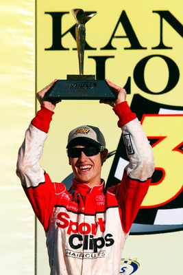 KANSAS CITY, KS - OCTOBER 02:  Joey Logano, driver of the #20 Sport Clips Toyota, celebrates in victory lane after winning the NASCAR Nationwide Series Kansas Lottery 300 on October 2, 2010 in Kansas City, Kansas.  (Photo by Jason Smith/Getty Images for N