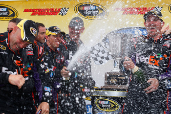 MARTINSVILLE, VA - OCTOBER 25:  Denny Hamlin, driver of the #11 FedEx Freight Toyota, celebrates in victory lane after winning the NASCAR Sprint Cup Series TUMS Fast Relief 500 at Martinsville Speedway on October 25, 2009 in Martinsville, Virginia.  (Phot