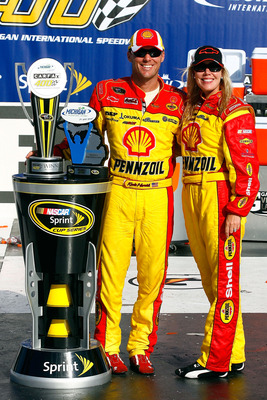 BROOKLYN, MI - AUGUST 15:  (L-R) Kevin Harvick, driver of the #29 Shell / Pennzoil Chevrolet and his wife DeLana celebrate with the trophy in victory lane after Keivn won the NASCAR Sprint Cup Series CARFAX 400 at Michigan International Speedway on August